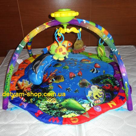 Дельфин-плюс - музыкальный развивающий коврик на дугах с каруселькой