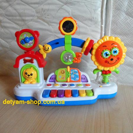 Музыкальный Городок - развивающая игрушка с разными звуками, мелодиями и подсветкой.