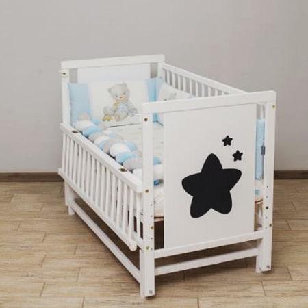 Детская кроватка Звездочка из бука со вставками МДФ и красивым рисунком звезд