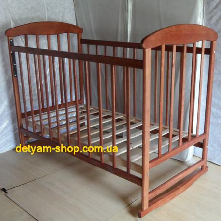 Детская кроватка Наталка ясень тонированный - прочная кроватка с колесами и качалкой