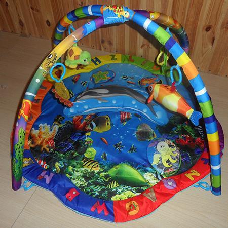 Дельфин - музыкальный развивающий коврик на дугах
