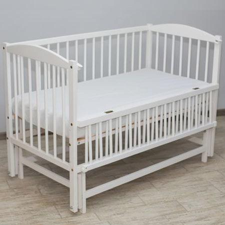 Веселка - люкс белая - кроватка на шарнирах с откидной стенкой