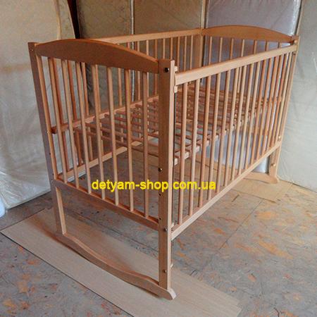 Антошка детская буковая кроватка с качалкой и колесами